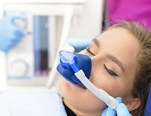 Woman in dental chair with nitrous oxide nose mask