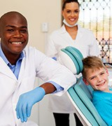 Dentist assistant and young boy in dental office