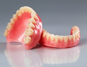 full dentures against a gray background