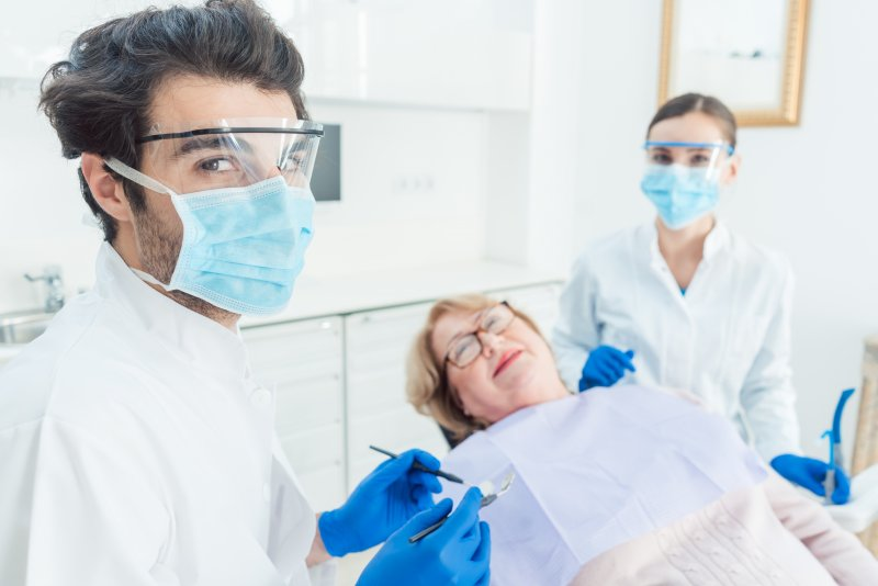 Dentist in Carrollton wearing PPE