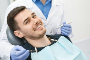 man smiling while visiting dentist in Carrollton