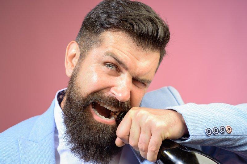 Man opening bottle with dental implants in Carrollton